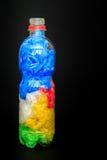Plast- flaska mycket av plastpåsar royaltyfria foton