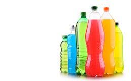 Plast- flaskor av blandade kolsyrade läsk över vit royaltyfria bilder