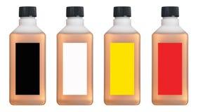 Plast-flaskor med kulör flytande inom Royaltyfri Bild