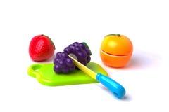 Plast-frukter som klipps i halva Royaltyfri Fotografi