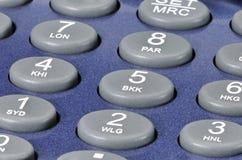 Plast-knappar på en blå grej Fotografering för Bildbyråer