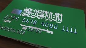 Plast- kontokort som presenterar flaggan av Saudiarabien Släkt animering för nationell banksystem arkivfilmer