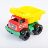 Plast- leksakförrådsplats på vit bakgrund Arkivfoto