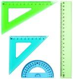 Plast- linjal, gradskiva, triangel som isoleras på vit backgroun royaltyfri foto
