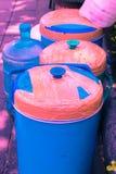 plast- pastellfärgad färg för tappningishink till idérik textur royaltyfria bilder