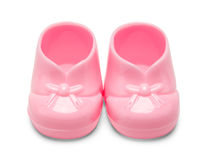 Plast- rosa färger behandla som ett barn skor Arkivfoto