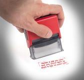Plast- stämpel i handen som isoleras Fotografering för Bildbyråer