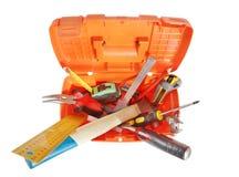 Plast- toolbox med olika funktionsdugliga hjälpmedel som isoleras över vit Royaltyfri Fotografi