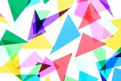 Plast- triangelbakgrund för färg Arkivbild