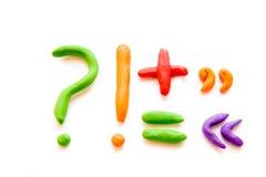 Plastellinabokstäver (tecken, siffror) Fotografering för Bildbyråer