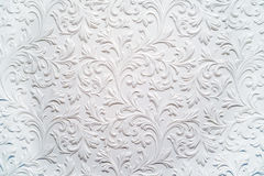 Plaster background floral pattern. White plaster relief background floral pattern in baroque style stock photos