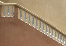 Plaster balistrade railing and stucco wall Stock Image