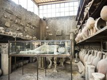 Plaster cast of one of the victims in the once buried Roman city of Pompeii south of Naples under the shadow of Mount Vesuvius Stock Photo