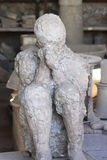 Plaster Cast of Seated Roman Men - Pompeii. The tremendous plaster cast of a roman men, during the eruption of Mount Vesuvius, in Pompeii which was mostly Stock Photography