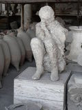 Plaster cast of a woman killed in Pompeii. Plaster cast of the body of a woman killed at the ancient Roman city of Pompeii, which was destroyed and buried by ash Royalty Free Stock Photo