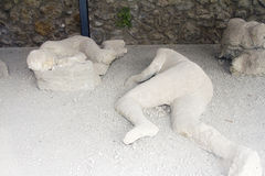 Plaster casts of two victims in Pompeii. Victims in Pompeii, an ancient Roman town destroyed by volcanic pyroclastic flows in 79 AD Royalty Free Stock Photos
