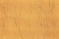Plaster or cement texture yellow color Royalty Free Stock Images