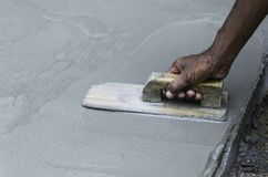 Plaster on the concrete. Workman plaster on the concrete Stock Images