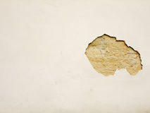 Plaster crubled off. Background with a Plaster crumbled off of an old alcient Masonry Wall Stock Image