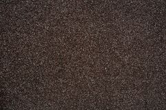 Plaster. Dark brown plaster with white large grain Royalty Free Stock Images