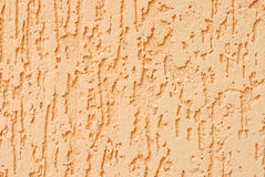 Plaster dark peach colour wall background.. Stock Photo