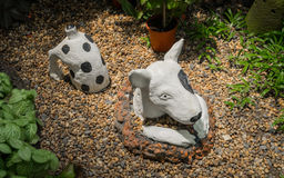 Plaster dog in the garden Stock Images