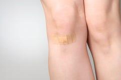Plaster on female leg Royalty Free Stock Image