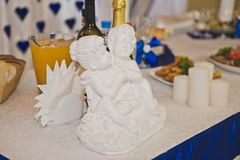 A figure hugging angels 7901. Plaster figurine of angels Stock Photos