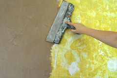 Plaster filling wall repair Royalty Free Stock Photography