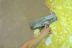 Plaster filling wall repair Royalty Free Stock Photos