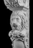 Plaster lion sculpture, pommel column. On a black background royalty free stock photo