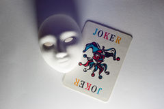 Plaster mask and joker. Who is joker, who is backup Royalty Free Stock Images