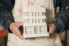 Plaster Model of Architectural Building Held by Person Stock Photos