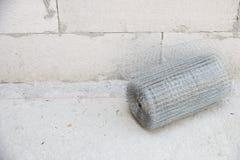 Plaster netting metal. Preparatory work of wire mesh before making plastering cement Stock Photos