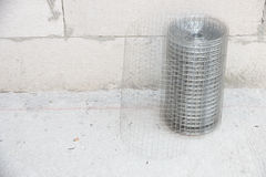 Plaster netting metal. Preparatory work of wire mesh before making plastering cement Stock Images