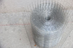 Plaster netting metal. Preparatory work of wire mesh before making plastering cement Stock Photography