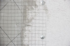 Plaster netting metal. Preparatory work of wire mesh before making plastering cement Royalty Free Stock Photo