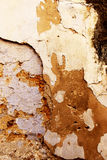 The plaster of an old wall. A detailed view of the colorful plaster of an old wall, from alcamo, sicily, portrait cut royalty free stock photography