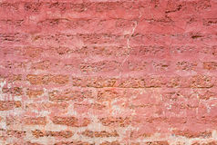 Plaster and painted red on Laterite stone brick wall Stock Photos