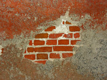 Plaster patches, bricks. Cracked wall with plaster patches Stock Photography