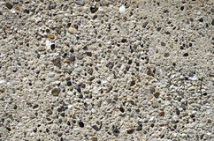 Plaster with pebbles on wall closeup Royalty Free Stock Photo