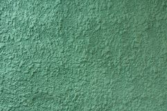 Plaster, putty, relief, on a colored wall. stock image