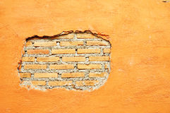 Plaster and Red brick wall damage Royalty Free Stock Photo