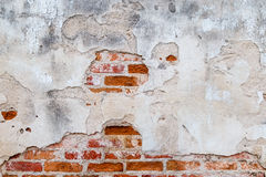 Plaster and red brick wall damage. Royalty Free Stock Photography