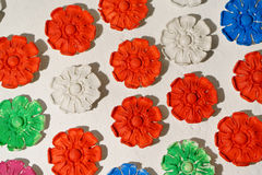 Plaster rosette, stucco in the form of flowers, leaves and flowers. backround. closeup. Plaster rosette, stucco in the form of flowers, leaves and flowers royalty free stock photography