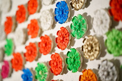 Plaster rosette, stucco in the form of flowers, leaves and flowers. backround. closeup. Plaster rosette, stucco in the form of flowers, leaves and flowers royalty free stock image