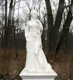 Plaster sculpture of a woman. Park Arboretum. Ukraine Stock Photo