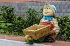 Plaster sculptures of assistants in a garden Stock Photo