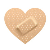 Plaster in shape of heart Royalty Free Stock Image