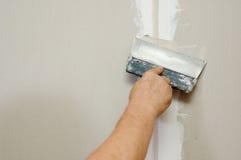 замазка plasterboard человека Стоковое фото RF